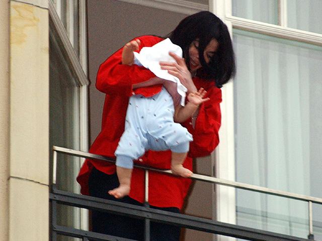 Michael Jackson dangling son Blanket over a balcony