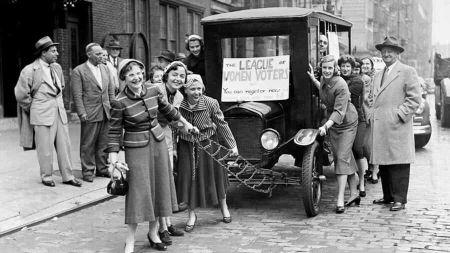 Members of League of Women Voters pull a 1922 Ford truck toward the Board of Elections at 400 Broome St. They brought the old vehicle along to call attention to the 'antiquity' of the registrations system