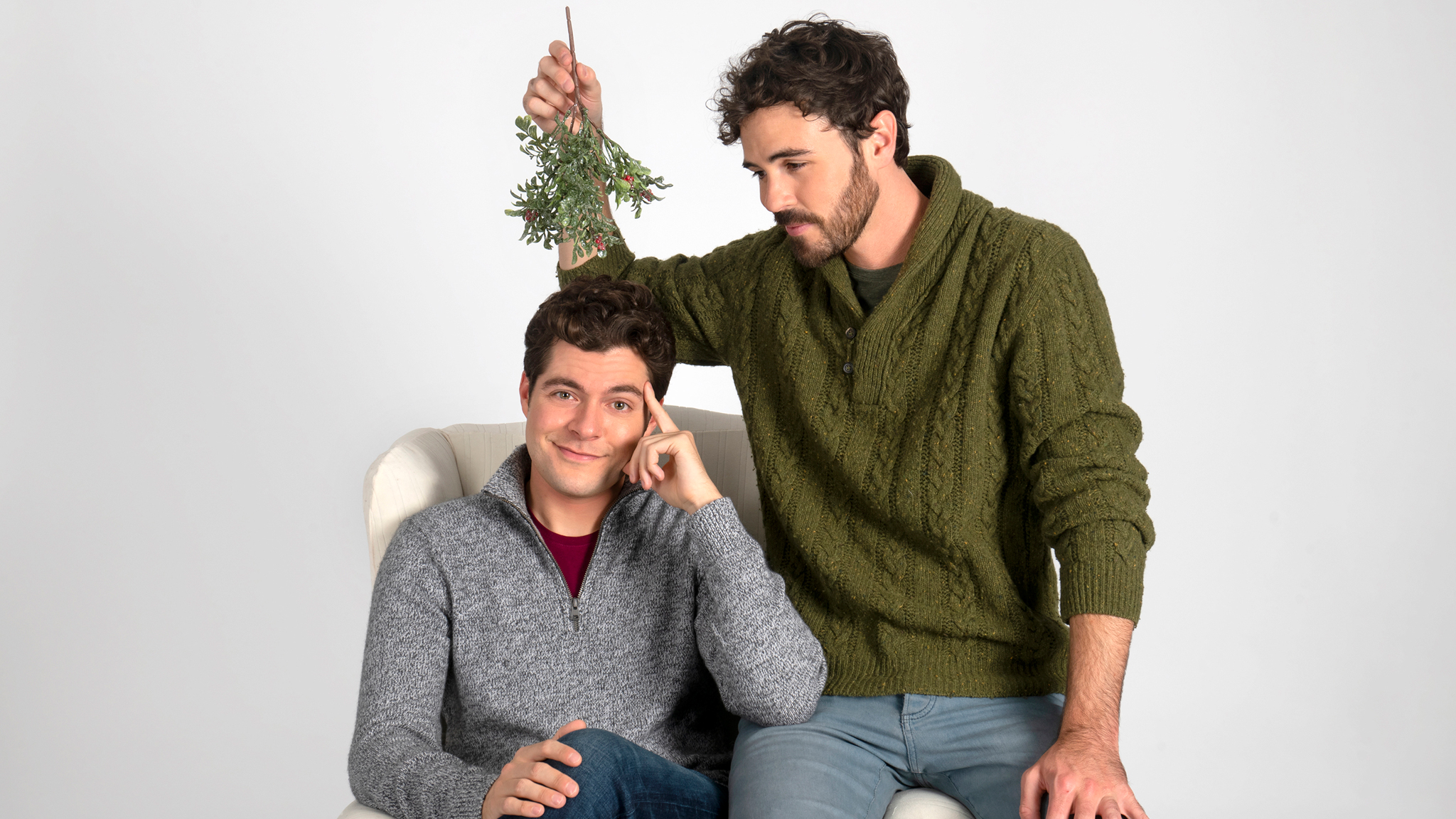 Ben Lewis and Blake Lee from Lifetime's 'The Christmas Setup' pose with mistletoe